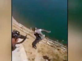 Soldados iraquianos jogam combatentes do ISIS de um penhasco e depois disparam contra eles